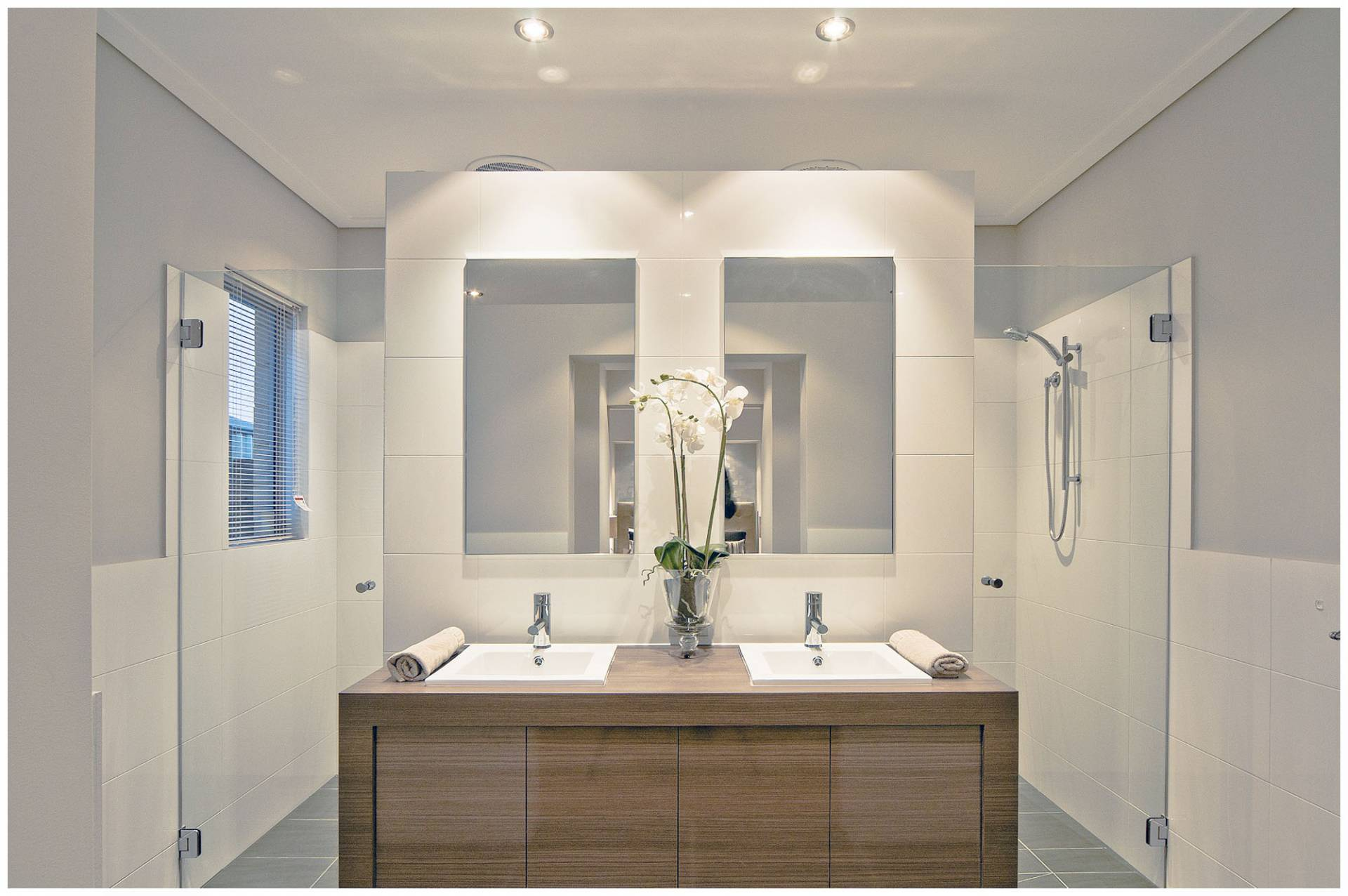 the espresso bathroom with double washing basins and shower with downlights