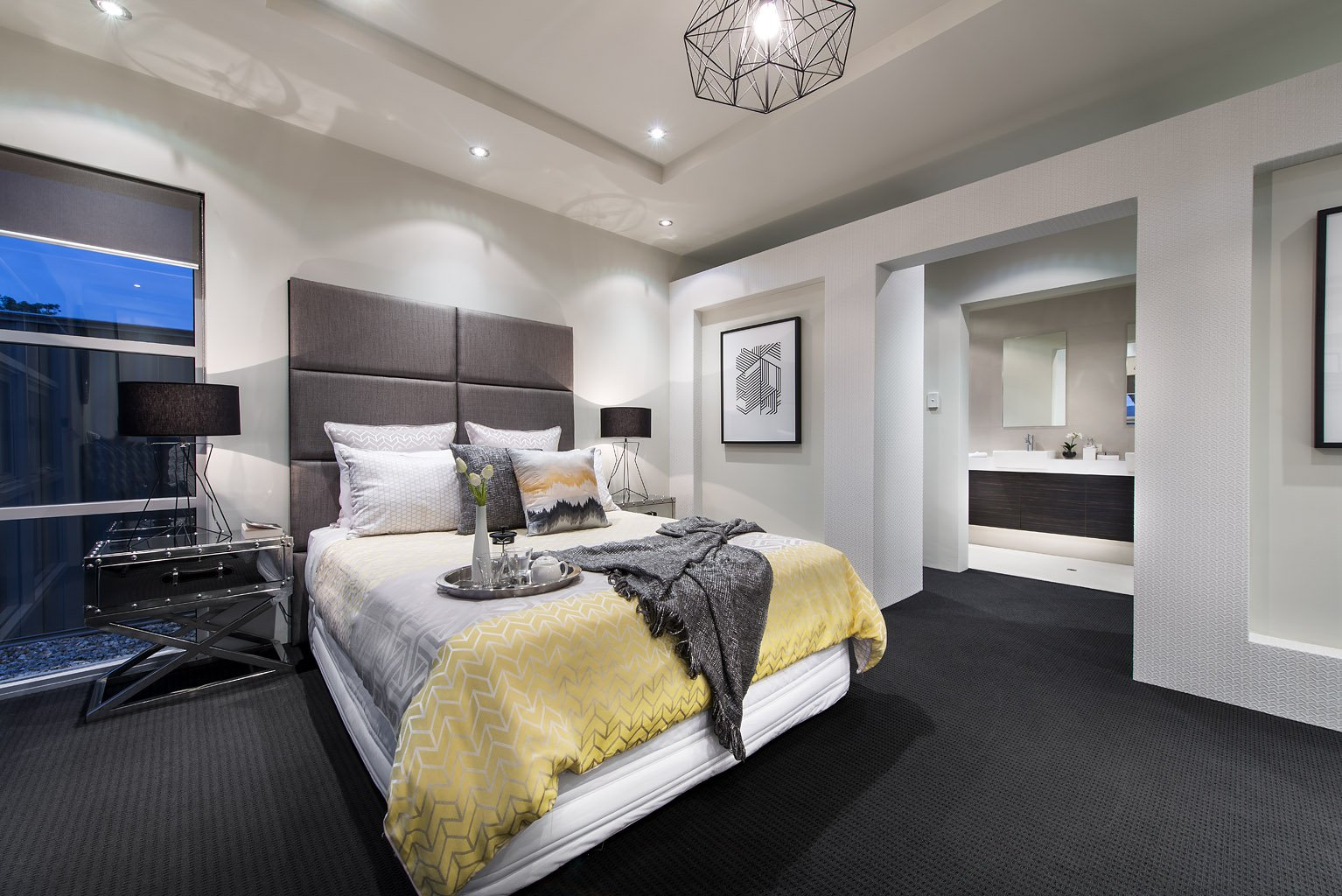 Luxurious style double bedroom with large bed, luxury designer furniture and private ensuite bathroom
