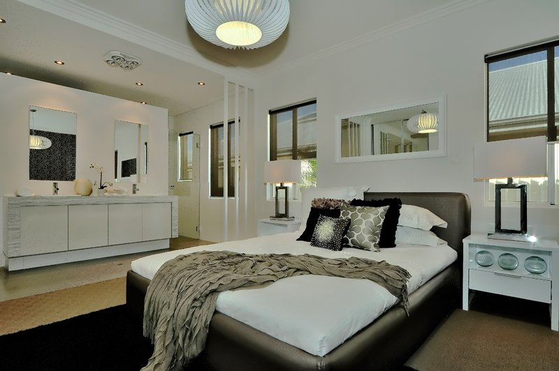 elegant house bedroom interior with light coloured basin and larger mirrors